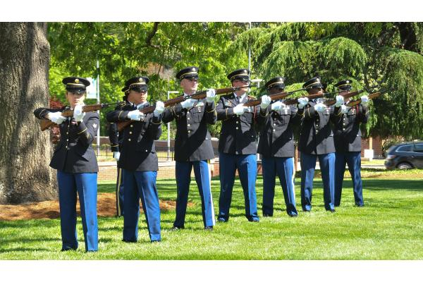 seven soldiers line up for 21 gun salute