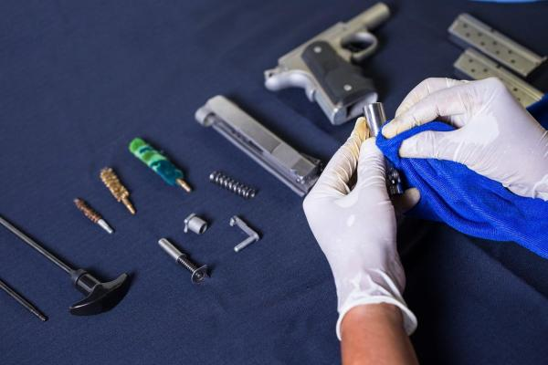 pistol disassembled for cleaning and supplies