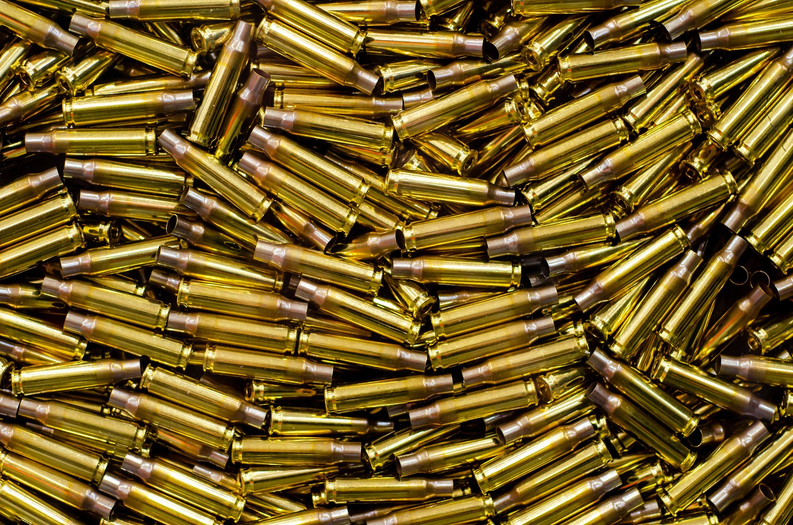 a pile of used or empty bullet casings